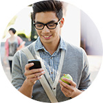 Young adult man looking at cell phone